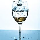 Splash of water and coins in a glass by Maxim Mayorov