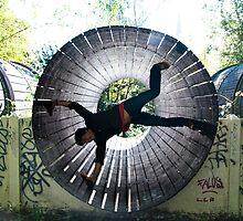 Man in a rolling tube by Maxim Mayorov
