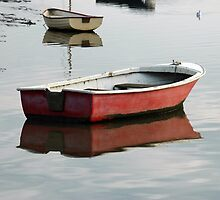 Dinghy reflection by Stan Daniels