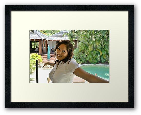 Attractive brunette businesswoman poolside by Ian McKenzie