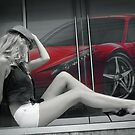 Attractive long leggy blond girl sitting in front of red Ferrari by Anton Oparin
