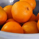 bowl of little oranges by tego53