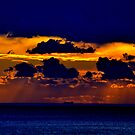 Blue, yellow, orange, and blue again. With a ship. by Turi Caggegi