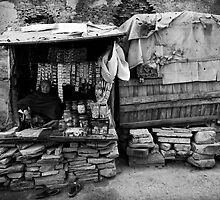 Shopkeeper in Street stall by Mark Smart
