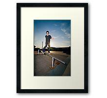 Skateboarder on a slide Framed Print