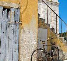old bicycle leaning on wall by Anne Scantlebury