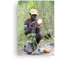 Mursi man applies bodypaint  Canvas Print