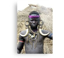 A Mursi tribesman warrior with warthog fangs earring decoration Canvas Print