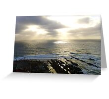 Rays of light touch a spot on the ocean Greeting Card