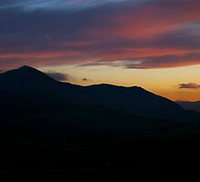 Skiddaw And The Setting Sun-  Lake District, Cumbria, Uk. by Lou Wilson