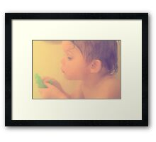 Toddler at bath with alligator toy Framed Print