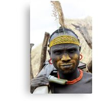 Mursi tribesmen. A nomadic cattle herder ethnic group located in Southern Ethiopia,  Canvas Print