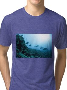 Scuba divers in the water  Tri-blend T-Shirt