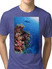 Scuba Divers pass by a coral reef photographed at Ras Mohammed  Tri-blend T-Shirt