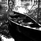 Canoe at Rest - Black and White Reflections by Jane Neill-Hancock