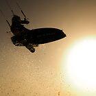 Kitesurfing at sunset in the Mediterranean sea  by PhotoStock-Isra