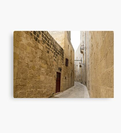 The Silent City - Big Walls Closing in and an Inviting Red Door in Mdina, Malta Canvas Print