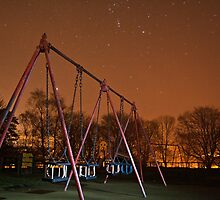 Swings At Night... by Lauren Tucker