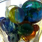 glass with marbles by tego53