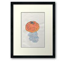an orange Framed Print