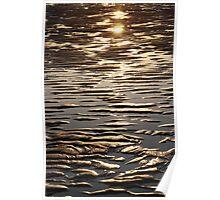 Sunset over wet sand Poster