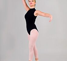 Female blond Ballet Dancer balances on her toes by PhotoStock-Isra
