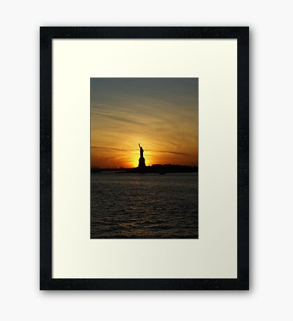 Lady Liberty with sunset Framed Print