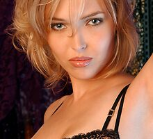 Beautiful blond woman in black bra by Anton Oparin