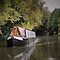 Narrowboats ( canal boats )  and / or Houseboats
