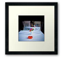 Rose on table Framed Print