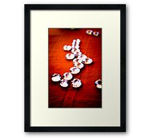 Glass beads on rust cloth Framed Print