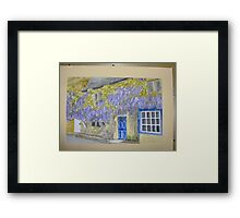 wisteria cottage in Broadway Framed Print
