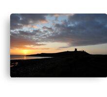 Dunstanburgh Castle at dawn Canvas Print