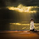 talacre lighthouse with sunbeams by meirionmatthias