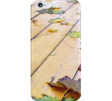 Close-up view on a wet green and yellow leaves of maple iPhone Case/Skin