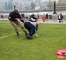 Boris Johnson slips and falls during tug or war by Keith Larby