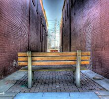 Bench in the alley by carlosramos