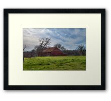 Old Red Shed on a Green Spot of Earth Framed Print