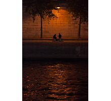 A couple down along the Seine at night Photographic Print