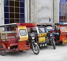 Tricycles in the Philippines by Henk van Kampen
