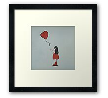 Girl with a Heart Shaped Balloon Framed Print