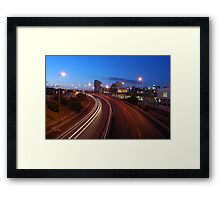 Freeway traffic on the city Framed Print