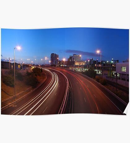 Freeway traffic on the city Poster