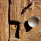 A Knob on An Old Brown door by Michele Filoscia