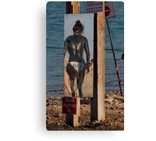 Black mud treatment at the Dead Sea Canvas Print