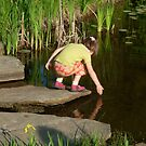 Girl at Fish Pond by Jan Morris