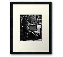 busker contemplating a prime location Framed Print