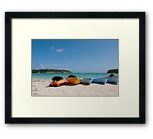Kayaks on beach Framed Print