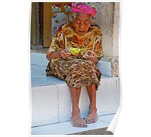 Old woman basket weaving on Nusa Penida, Bali, Indonesia Poster