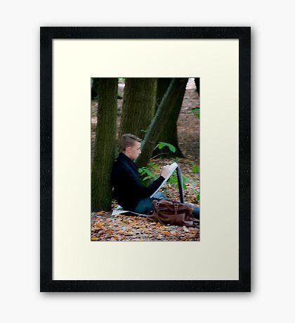 Young artist sketching in Middleheim Sculpture Park, Antwerp, Belgium Framed Print